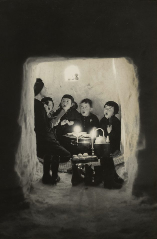"""Children Singing in a Snow Cave, Niigata Prefecture"" (1956) by Hiroshi Hamaya, gelatin silver print, © Keisuke Katano, The J. Paul Getty Museum, Los Angeles."
