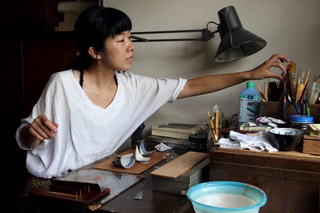 Mio Heki working at her desk